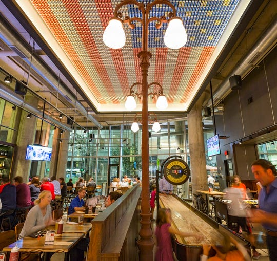 Interior of Americano, showing flag made of beer cans