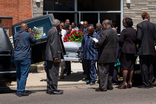 The casket of Derrick R. Fudge, 57, is loaded into a hearse outside of St. John Missionary Baptist Church in Springfield, Ohio, on Saturday, Aug. 10, 2019. Fudge was one of the victims of the Dayton, Ohio, mass shooting.