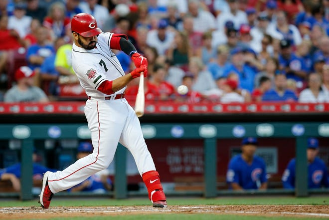 Cincinnati Reds third baseman Eugenio Suarez (7) hits a 430-foot solo home run in the fourth inning of the MLB National League game between the Cincinnati Reds and the Chicago Cubs at Great American Ball Park in downtown Cincinnati on Friday, Aug. 9, 2019. The Reds led 3-1 after four innings.