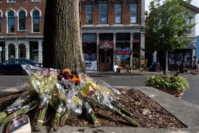 A makeshift memorial is erected outside of Ned Peppers Bar in the Oregon District of Dayton, Ohio on Saturday, August 10, 2019.