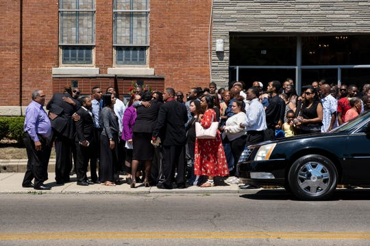 Mourners stand outside of the funeral services of Derrick R. Fudge, 57, on Saturday, August 10, 2019 at the St. John Missionary Baptist Church in Springfield, Ohio. Fudge was the victim of a mass shooting at Ned Peppers Bar in the Oregon District of Dayton, Ohio.