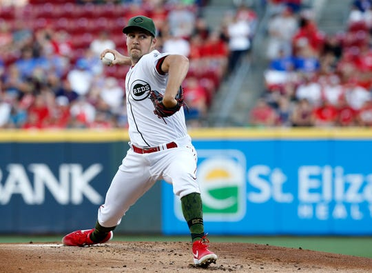 Cincinnati Reds starting pitcher Trevor Bauer (27) delivers a pitch in the first inning of the MLB National League game between the Cincinnati Reds and the Chicago Cubs at Great American Ball Park in downtown Cincinnati on Friday, Aug. 9, 2019. The Reds led 3-1 after four innings.