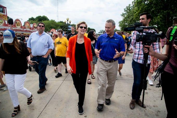 U.S. Sen. Elizabeth Warren, D-Mass., walks through the Iowa State Fair on Saturday, Aug. 10, 2019, in Des Moines.