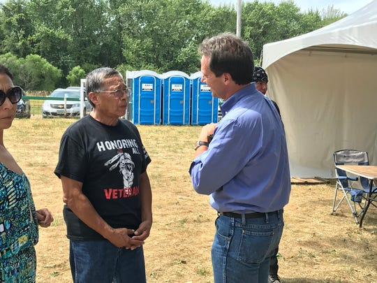 Montana Gov. Steve Bullock, right, speaks with Meskwaki tribal council chairman Anthony Waseskuk on Saturday at the Meskwaki Powwow.