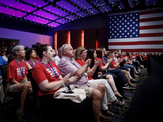 Attendees of the Presidential Gun Sense Forum applaud Sen. Kirsten Gillibrand's response to a question on Saturday, Aug. 10, 2019, at the Iowa Events Center in Des Moines.