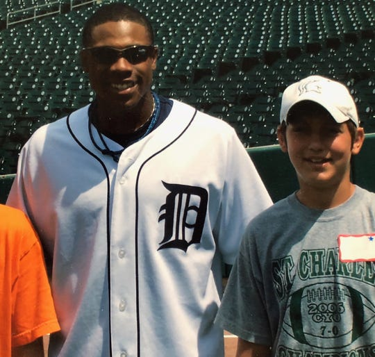 12 years before he made his Tigers debut, John Schreiber was on the Comerica Park field, for a kids camp attended by then-Tigers outfielder Curtis Granderson.