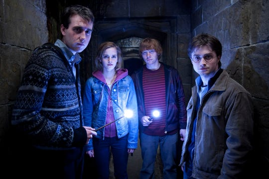 "Matthew Lewis, left, as Neville Longbottom with the cast of ""Harry Potter and the Deathly Hallows: Part 2."""