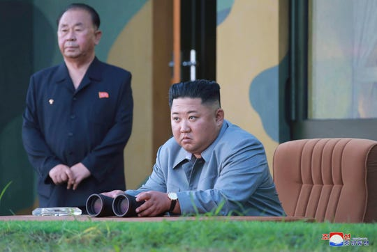 In this July 25, 2019, photo provided by the North Korean government, North Korean leader Kim Jong Un watches a missile test in North Korea.