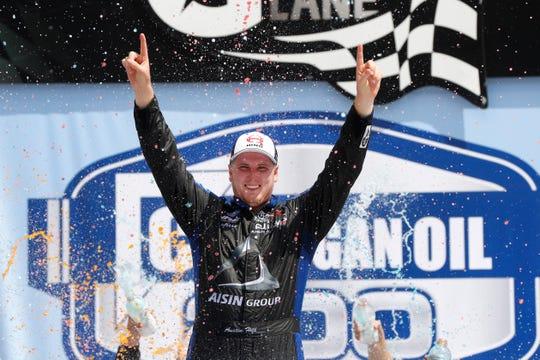 Austin Hill celebrates winning the Turck Series race Saturday at MIS.