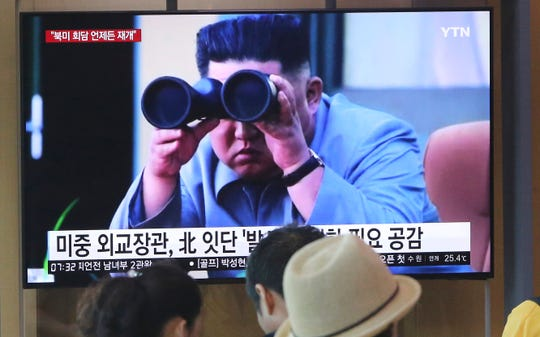 People watch a TV showing a file footage of North Korean leader Kim Jong Un during a news program at the Seoul Railway Station in Seoul, South Korea.