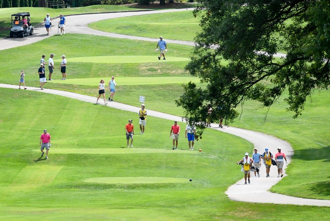 Golfers approach number 14 during the third round of the Men's City golf tournament at Rolling Hills Country Club Saturday, August 10, 2019.