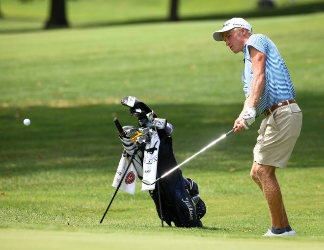 Adam Bratton hits his approach shot on number 15 during the third round of the Men's City golf tournament at Rolling Hills Country Club Saturday, August 10, 2019.