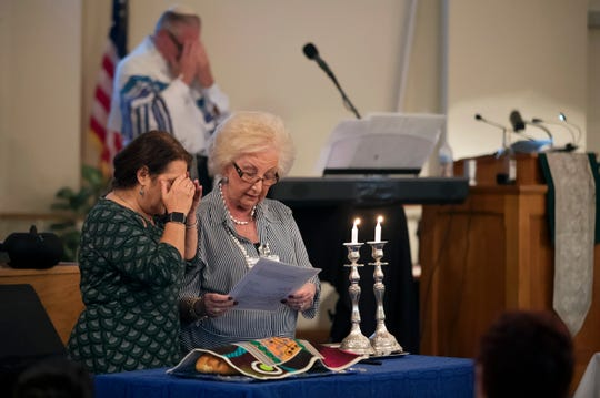 Robin Dermer, left, and Barbara Amor lead service on Friday for the Shalom Life Center in Fort Myers.