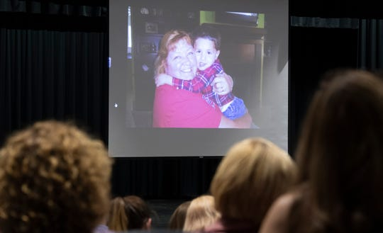 Photos of Cheryl Theodoroff flash on a screen in the auditorium at West-Oak High School during a memorial for Cheryl Theodoroff Saturday, August 10, 2019.