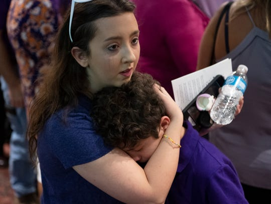 MacKenzie Lyle, a former student of Cheryl Theodoroff's, hugs Theodoroff's grandson Nathan Alemar, 10, during a memorial for Cheryl Theodoroff at West-Oak High School Saturday, August 10, 2019.