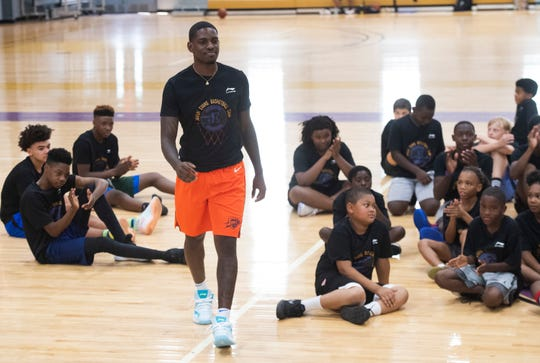 Jawun Evans walks to the front of the crowd to speak to campers at the Jawun Evans Basketball Camp held at Legacy Early College Saturday, August 10, 2019.