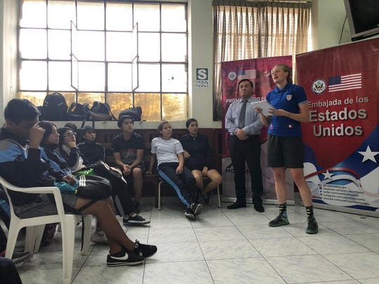 Lizzie Thompson of Great Falls speaks to Peruvian students about how soccer helped improve self-esteem.