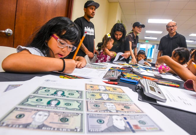 Children, and several of their parents, learn basic money management skills during a Ha'anen Familia event at the Senator Antonio M. Palomo Guam Museum & Educational Facility in Hagåtña on Saturday, Aug. 10, 2019. Youngsters, 6- through 13-years old, were offered lessons in good saving and spending money habits during a special session with employees from the Bank of Guam.