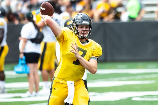 Iowa quarterback Spencer Petras (7) throws a pass during a Hawkeyes football Kids Day scrimmage, Saturday, Aug. 10, 2019, at Kinnick Stadium in Iowa City, Iowa.