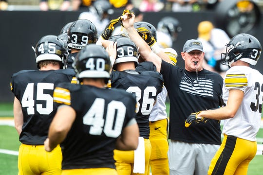 Chris Doyle, right, has been arguably the most influential person in the Iowa program (Kirk Ferentz included) since coming aboard in 1999.