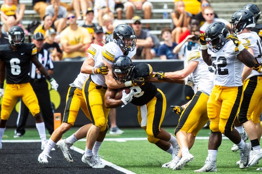 Iowa running back Toren Young (28) breaks past defenders into the end zone during a Hawkeyes football Kids Day scrimmage, Saturday, Aug. 10, 2019, at Kinnick Stadium in Iowa City, Iowa.