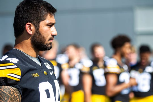 Iowa defensive end A.J. Epenesa (94) speaks with reporters during Hawkeyes football media day, Friday, Aug. 9, 2019, at the University of Iowa outdoor practice facility in Iowa City, Iowa.