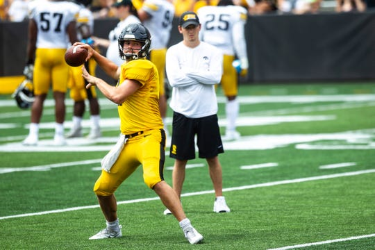 Iowa quarterback Peyton Mansell (2) throws a pass during a Hawkeyes football Kids Day scrimmage, Saturday, Aug. 10, 2019, at Kinnick Stadium in Iowa City, Iowa.