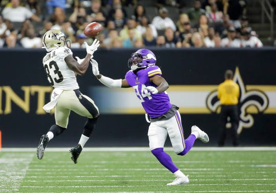 New Orleans Saints wide receiver Cyril Grayson (83) catches a pass over Minnesota Vikings defensive back Duke Thomas (34) on Friday at the Mercedes-Benz Superdome.
