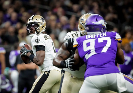 New Orleans Saints quarterback Teddy Bridgewater (5) looks to throw against the Minnesota Vikings during the first quarter at the Mercedes-Benz Superdome.