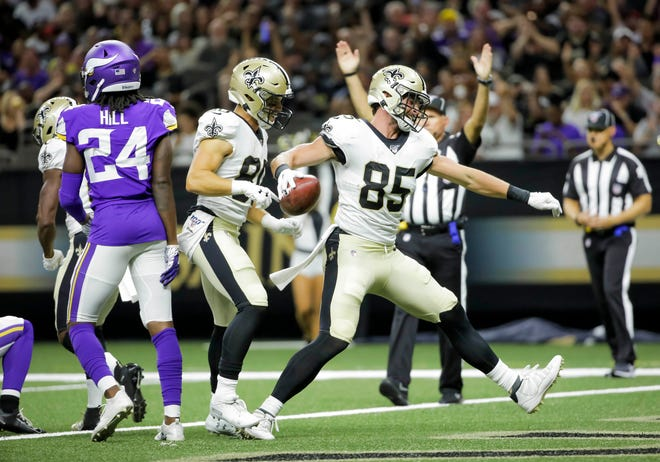 New Orleans Saints tight end Dan Arnold (85) spikes the ball after a touchdown against the Minnesota Vikings on Friday at the Mercedes-Benz Superdome.