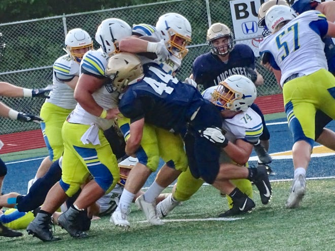 Lancaster's A.J. Locke tackles an Olentangy runner during Friday night's scrimmage at Fulton Field.