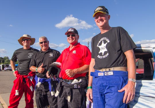 From left, Ingham County Sheriff Scott Wriggelsworth, Clinton County Sheriff Larry Jerue, Eaton County Sheriff Tom Reich and Livingston County Sheriff Michael Murphy band together at Corrigan Oil Speedway Friday, Aug. 9, 2019 for a race among sheriffs to benefit the winner's choice of charities.