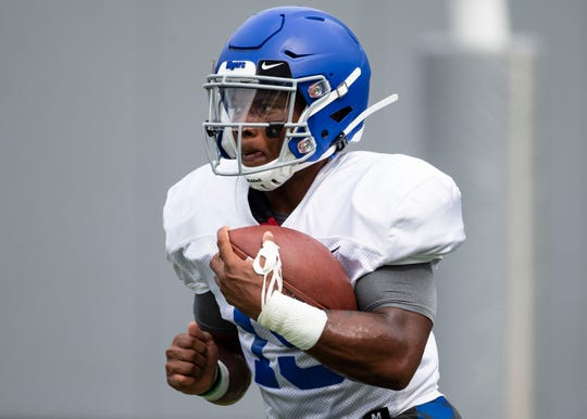 Memphis Tigers warm up before the 1st scrimmage of preseason practice in the Liberty Bowl,Saturday, August 10, 2018.