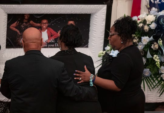 Family and friends attend the funeral of Brandon Gales, who died on July 30 after being shot at the Walmart in Southaven, Mississippi.