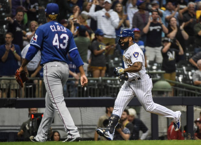 The Brewers' Eric Thames runs the bases after hitting a walkoff home run against Texas Rangers pitcher Emmanuel Clase.
