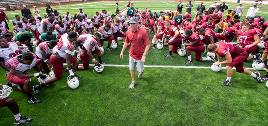 Troy head coach Chip Lindsey with his team after a football scrimmage on campus in Troy, Ala., on Saturday August 10, 2019.