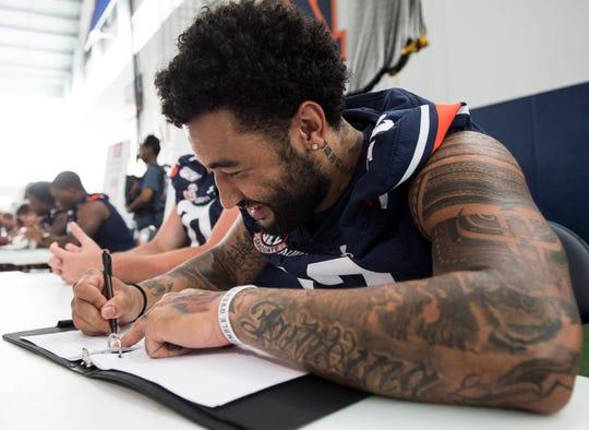 Auburn's Jay Jay Wilson signs autographs during Auburn Fan Day on Saturday, Aug. 10, 2019.