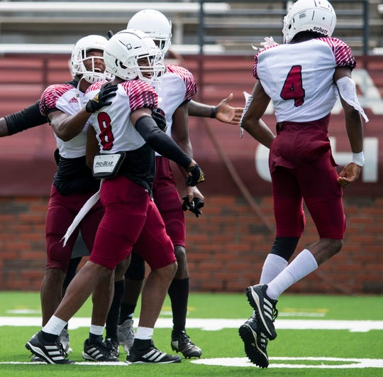 Troy safety TJ Harris (8) is congratulated after scoring a touchdown on an interception during  Troy's scrimmage on campus in Troy, Ala., on Saturday August 10, 2019.