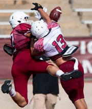 Troy safety Micah Murphy (13) breaks up a pass in the end zone intended for Troy tight end Sam Letton (17) as Troy University holds a football scrimmage on campus in Troy, Ala., on Saturday August 10, 2019.