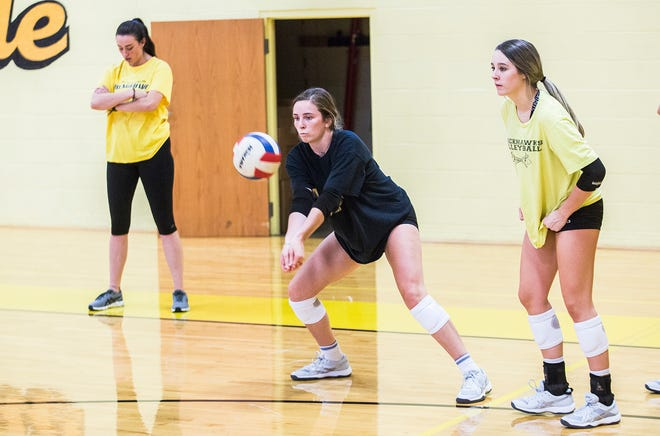 FILE -- Cowan volleyball players compete during an early-August practice.