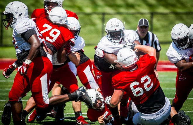 Ball State's Emeka Jillani powers through the offensive line during the team's scrimmage at Scheumann Stadium Saturday.