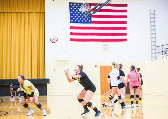 Cowan High School volleyball players practice Friday, Aug. 9, 2019.