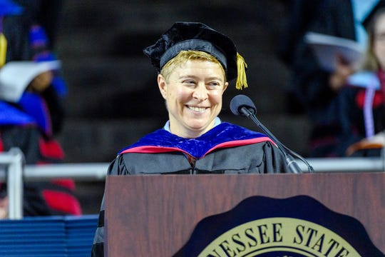 MTSU history professor Pippa Holloway grins at the audience's response to her remarks at the university's summer 2019 commencement ceremony Saturday, Aug. 10, in Murphy Center.