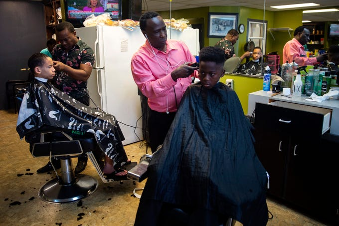 Photos: Naples barber shop offers free haircuts for students