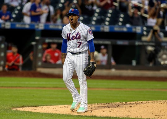 New York Mets pitcher Marcus Stroman (7) reacts after a strikeout to end the third inning against the Washington Nationals at Citi Field.