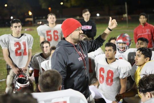 Rob Gentile (center) is the head coach for the Fair Lawn High School football team.