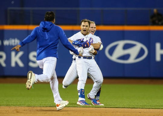 Aug 9, 2019; New York City, NY, USA; New York Mets center fielder Michael Conforto (30) is grabbed by first baseman Pete Alonso (20) after hitting a walk off RBI single to beat the Washington Nationals 7-6 at Citi Field.