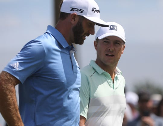 Dustin Johnson and Jordan Spieth walk the fairway on 5 after teeing off while competing in the Northern Trust at Liberty National Golf Club in Jersey City on August 10, 2019.
