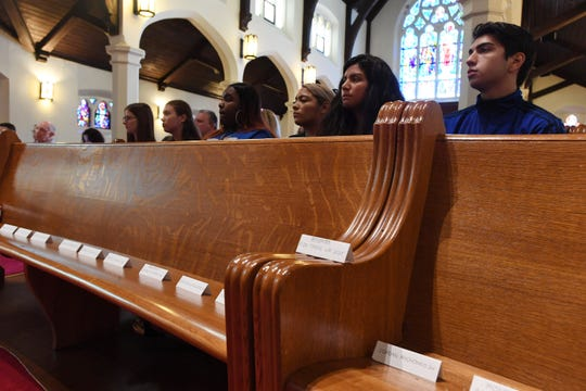 March For Our Lives New Jersey vigil in remembrance of victims from El Paso and Dayton, as well as victims of gun violence from Chicago and New Jersey at Emmanuel Baptist Church in Ridgewood on Saturday, August 10, 2019. Names of victims from El Paso and Dayton on a pew in the front row.