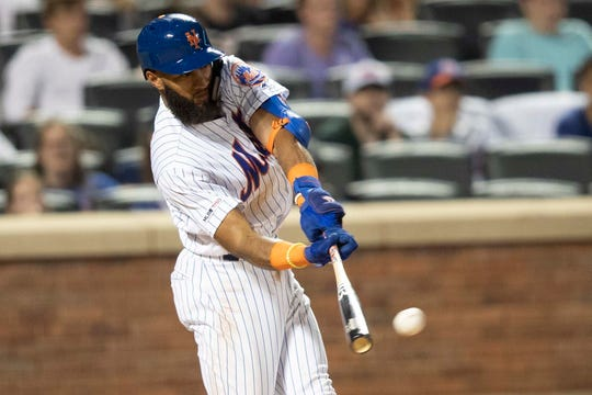 New York Mets' Amed Rosario hits a double during the eighth inning of a baseball game against the Washington Nationals, Friday, Aug. 9, 2019, in New York.